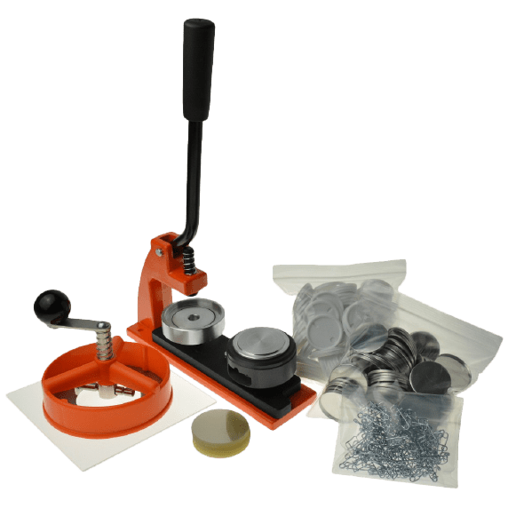 Orange Micro Assembler package including badge machine, circle cutter, perspex cutting board with badge components comprising of white plastic backs, metal fronts, crimp pins and clear plastic mylar film coverings